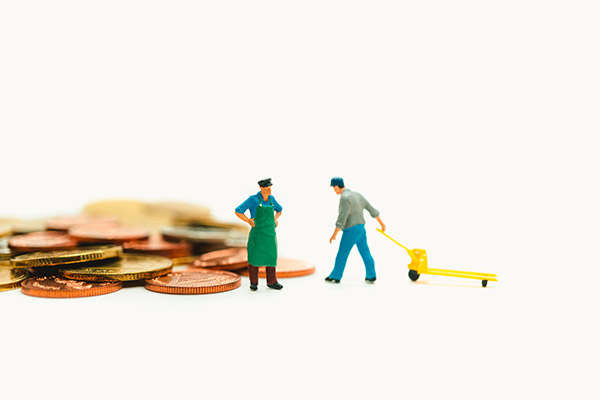 Miniature people, chief control worker lifting stack coins using