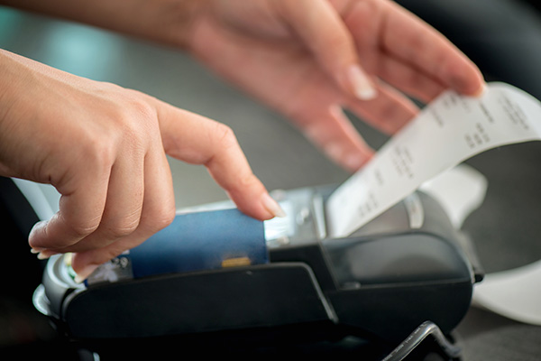 Hand taking receipt from pos
